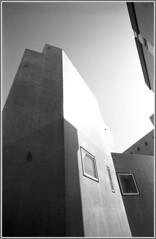 Lisboa; modern residential construction. RESPECT the copyright. (YoLeenders) Tags: blackandwhite portugal lisboa streetphotography rangefinder analogphotography architectuur nikonsupercoolscan5000ed delta100asa elmaritm12821mmasph developerid11ilford11 leicam6ttl075 httpwwwflickrcomphotosyole2008
