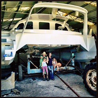 024/365 • the four of us, just before the catamaran was pulled out of the shed - this was started before the Smalls were born • #024_2015 #catamaran #bigday #outfromunder #gettingready #boatbuilding #bellaluna #shed #multihull