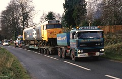A2-166.  Looks like we've got us a convoy !! 50021 on low loader has now built up quite a queue of traffic. A436 at Seven Springs. 24th November 1992. (cotswold45) Tags: