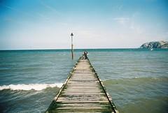 (Fellhunter) Tags: ocean greatbritain travel sea wales 35mm landscape photography view britain father cymru son olympus tourist 35mmfilm british welsh analogue fatherandson llandudno 35mmphotography olympusom10 northwales travelphotography analoguecamera analoguephotography originalphotography photographersoftumblr
