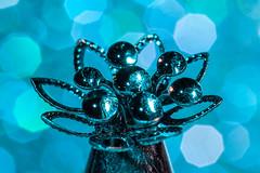 Macro Mondays - Anything Goes (Evelyn Ford) Tags: macro metal bokeh turquoise decoration embellishment waterdrops anythinggoes strobist macromondays canoneos5dmarkii ef100mmf28lmacroisusm