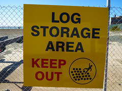 Log Storage Area - Keep Out (Steve Taylor (Photography)) Tags: blue red newzealand man black sign yellow scary log nelson storage plastic nz area southisland rolling keepout