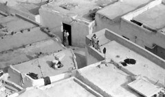 On the roofs of Fes, Morocco, 1984 (Juha Riissanen) Tags: houses roof people bw baby white black traditional terraces mother morocco processed fes alleys moroccomarokko 1984interrail