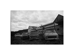 car cemetery (Marek Pupk) Tags: blackandwhite bw film monochrome cemetery car analog europe central documentary xp2 slovakia ilford a2 canon5