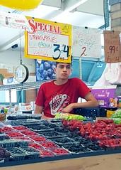 bored fruitier (Tim Evanson) Tags: cleveland teenager fruitstand westsidemarket vegetablestand