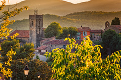 The Church in the Distance (JSP92) Tags: trees sunset france tower church leaves golden bell steeple hour lamps fr montauroux provencealpesctedazur