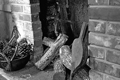 Thinking of Christmas? (John Ilko) Tags: monochrome rural vintage blackwhite fireplace logs hearth fujifilm 1855mm palmetto