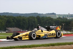 Graham Rahal crests the Keyhole Turn (Turn 2) at the Mid-Ohio Sports Car Course` (IndyCar Series) Tags: grahamrahal exposure11000 hondaindy200atmidohio meteringmode5 isospeedrating640 fnumber7110 cameracanoneos1dmarkiii rahallettermanlaniganracing focallength1951