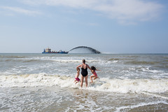 (Peter de Krom) Tags: sea beach kids lady coast boat jump sand horizon wave spray rijkswaterstaat hvh