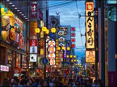 Dotonbori Evening (David Panevin) Tags: street sky people signs japan clouds buildings lights evening restaurants olympus  shops osaka kansai dotonbori omd  urbanfragments em5 davidpanevin mzuikodigitaled45mmf18