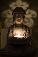 Buddah-2 (mkdaily) Tags: portrait contrast warm candle shadows flames candlelight buddah candleflame