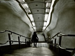 Uncertainty (IngeniousImages) Tags: city uk travel urban bw london monochrome silhouette stairs underground subway mono metro transport tube steps tunnel gb urbex uploaded:by=flickrmobile flickriosapp:filter=nofilter vision:text=055 vision:outdoor=0512 vision:plant=0731 vision:street=072 lancastergatelondonundergroundstation