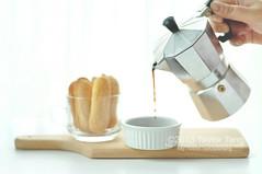 In the making of tiramisu (TailorTang) Tags: stilllife food coffee 50mm whitebackground choppingboard ramekin ladyfinger mokapot