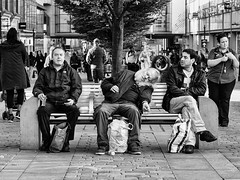 Three Geezers (Peter.Bartlett) Tags: briefencounters candid manchester bag bench blackandwhite cigarette city drink eyecontact litter lunaphoto m43 man men microfourthirds monochrome niksilverefex olympusomdem5 people sitting smoking streetphotography uk unitedkingdom urban urbanarte woman