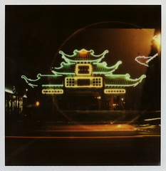 Chintown Plaza Gateway (tobysx70) Tags: california ca door plaza light toby color film night project polaroid sx70 for la los downtown neon nocturnal traffic angeles tail broadway trails halo illuminated tip cameras 600 gateway type headlight lit rollers hancock slr680 dtla impossible the chintown frankenroid impossibleproject tobyhancock impossaroid