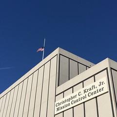 Flag flying half mast outside the Christopher C. Kraft Jr.  Mission Control Center at #JSC #NASARemembers #NASAIntern