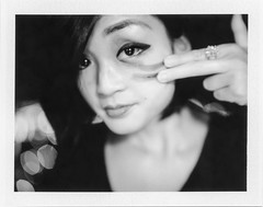 Paint it Black (Ca$hreno) Tags: nightphotography portrait film beauty night polaroid fuji bokeh vintagecamera epson fujifilm filmcamera blackeye warpaint beautifulgirl filmphotography blackandwhitefilm v700 blackpaint polaroid195 fp3000b closeupkit
