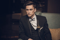 Young confident businessman sitting in armchair. Close up (papulov74) Tags: boy portrait people white man black male guy beautiful smart fashion businessman wall modern dark studio person one cool model chair sitting looking serious expression contemporary background room rich young handsome lifestyle tie style business suit trendy attractive casual elegant armchair relaxed success glance isolated confident appearance stylish caucasian