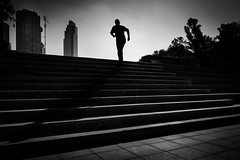 Climbing stairs in backlight (hzeta) Tags: city bw en white black blanco silhouette backlight stairs buildings contraluz edificios shadows y negro steps ciudad running run bn climbing backlit silueta sombras escaleras corriendo correr escalones subiendo escalinatas
