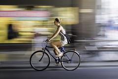 Woman on Bike (kohlmann.sascha) Tags: street people woman blur bike bicycle donna cyclist traffic femme mulher streetphotography technik blurred menschen motionblur ciclista bicyclist frau technique verkehr unscharf youngwoman velo fahrrad cycliste mensch bewegungsunschärfe twowheeler 女人 jungefrau jeunefemme unschärfe fortbewegungsmittel 女子 bicyclerider fahrradfahrer zweirad biciclo deuxroues streetfotografie laseñora strasenfotografie elciclista 两轮车 же́нщина велосипеди́ст фра́у