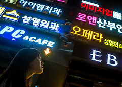 North korean teen defector in front of neon lights in the street, National capital area, Seoul, South korea (Eric Lafforgue) Tags: city urban woman streets horizontal night buildings advertising asian outdoors lights town colorful asia neon place outdoor refugee capital sightseeing korea location seoul teenager colourful southkorea youngadult interest metropolitan oneperson defector 1819years northkorean 1617years 1people colourpicture koreanscript koreanethnicity sk162380
