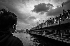 jump (Emily Jones / Emel Akar) Tags: street bridge boy sea people blackandwhite bw turkey blackwhite jump waiting streetphotography istanbul galatabridge themarmarasea