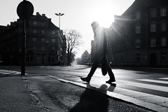 Early Meeting (marcin baran) Tags: black whote white blackwhite blackandwhite bw monochrome sun sunny sunshine morning light ray man human person silhouette building road street streetphotography urban gliwice poland polska marcinbaran shadow fuji fujifilm x100 x100t