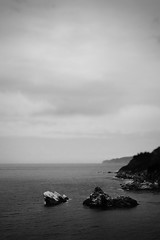 No man's an island (Howard Sandford) Tags: sea sky blackandwhite bw monochrome rock landscape calm stillness bnw