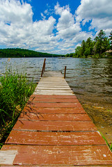 Old Red Dock (Catskills Photography) Tags: red sky lake water clouds landscape dock wideangle shore canon1022mmlens