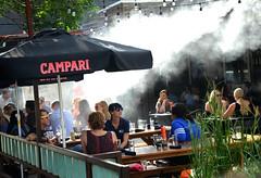Dining in the Mist (photographyguy) Tags: mist umbrella restaurant colorado denver tables dining campari picnictables outsidedining aceeatserve