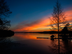 Fire and ice (Suho_Ja) Tags: winter finland ice water red orange blue dark silhouette tree lake