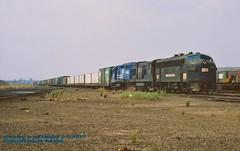 .CR 1692-2734-3671, NY-74, Seacaucus, NJ. 5-24-1977 (jackdk) Tags: railroad train railway ge cr coveredwagon freighttrain conrail f7 emd croxton f7a secaucusnj emdf7a gp35 emdgp35 u23b gelocomotive croxtonyard