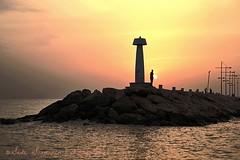 #Sunset (suominensde) Tags: sunset sea people lighthouse tower silhouette faro mar nikon mediterranean torre gente outdoor cyprus silueta mediterrneo breakwater puestadelsol rompeolas chipre flickrfriday d3100