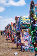 Cadillac Ranch i (Eric Baggett) Tags: blue sky art love graffiti colorful texas americana spraypaint cadillacranch iconic photosofart sonya7rii sonyfe2470mmgm