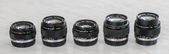 5 Om Zuikos (kuuan) Tags: olympus om zuiko manualfocus lenses f1850mm f224mm f28100mm f285mm f228mm olympusomsystemzuikof2824mm olympuszuikof228mm olympuszuikof1850mm fzuikof285mm olympiuszuikof28100mm