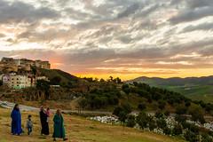 Walking on sunset (Davide Bonaldo) Tags: family sunset portrait panorama cemetery children landscape women veil muslim islam morocco fes
