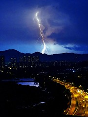 Monster (unlimited inspirations) Tags: light summer sky mountain storm building cars home nature weather monster night clouds hongkong gold highway sony magic electricity thunderstorm yuenlong