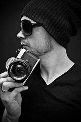Self Portrait (ChrisJohnston82) Tags: camera portrait people blackandwhite bw selfportrait man male hat sunglasses self canon eos mono blackwhite filmcamera canoneos fujica beenie canonefs1855mmf3556 fujicaax1 400d eos400d canoneos400d canon400d fujicacamera