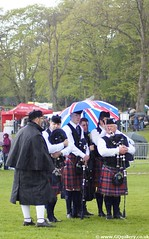 Pipe Band Championships 2013 (GQ Gallery) Tags: carnival green rain umbrella kilt mayor pipe band scottish an parade bands pip co northernireland british bagpipes kilts unionjack unionflag tartan lisburn antrim 2013 lisburnmayorsparade2013 lisburnmayorsparade lisburnmayorscarnivalparade