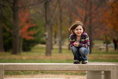 Fall in the Park (Jeffrey Deal) Tags: park family autumn trees red fall girl bench necklace sweater little daughter greed