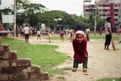 Colors of Bangladesh... (Sheikh Shahriar Ahmed) Tags: street red green film smile kids analog kid child flag streetlife fujifilm dhaka jolly bangladesh banasree nikonf6 childportrait kidportrait tupi af50mmf18d fujicolorc200 dhakadivision epsonv330 sheikhshahriarahmed madrasaah