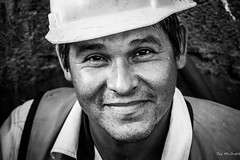 Zihuatanejo Mexico - Nov 13 - Happy Worker (George Walker Bush look-a-like?) (Ted's photos - For me & you) Tags: travel hardhat portrait bw smile face hat pose beard mexico nose happy blackwhite georgewbush posing lips cheeks sweat grin zihuatanejo stubble pleased sweating georgewalkerbush tedsphotos natgeofacesoftheworld zihuatanejoguerrero presperation vision:people=099 vision:face=099 vision:portrait=099 vision:outdoor=0704