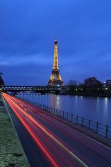 Lights & Paris (espinozr) Tags: longexposure sunset paris tower luz atardecer fav50 eiffel torreeiffel bluehour francia lighttrail fav10 fav25 2013 horaazul vision:outdoor=0966 vision:sky=0703