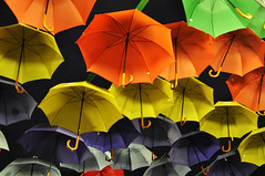 Coloured brollies (Roving I) Tags: colours parks vietnam nightlife umbrellas saigon hcmc hochiminh funfairs