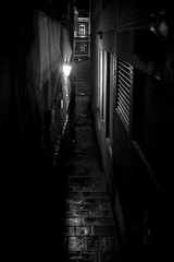 Narrow street (George Alexander Ishida Newman) Tags: street blackandwhite wet monochrome rain night buildings bristol vent lights noir lamps narrow