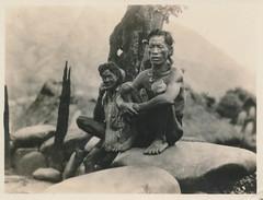 Tribal men squat on rocks (simpleinsomnia) Tags: old white man black men monochrome vintage found blackwhite asia pacific native antique snapshot tribal photograph vernacular tribe anthropology foundphotograph