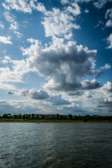 Cloud over the Rhine (Job I) Tags: blue houses sky cloud river germany europe cityscape riverside nrw dsseldorf rhine