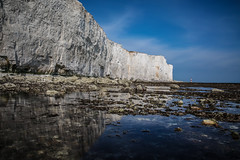 Cliff side (Ashley Hemsley) Tags: camera uk trip england lighthouse white seascape motion reflection art water beauty speed canon season landscape photography sussex chalk spring still movement long exposure artist view shot walk top south united horizon creative kingdom visit tourist cliffs east explore reflect pools fallen shutter eastbourne 5d coastline dslr distance waterscape rockpools uinque neature zomei
