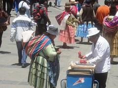 Buying ice cream in Plaza San Francisco (virharding) Tags: bolivia bowlerhat lapaz cholita