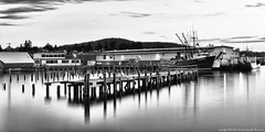 2016-05-24 Trident Seafoods Plant (B/W) (Long Exposure) (2048x1024) (-jon) Tags: longexposure blackandwhite bw reflection abandoned night pier boat fishing dock ship vessel skagit pugetsound sanjuanislands anacortes washingtonstate longexpsoure skagitcounty guemeschannel salishsea fidalgoisland tridentseafoods curtiswharf fvoregon a266122photographyproduction fvstmichael fvviking